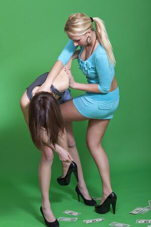 knee hit - two young women fighting on green background photo