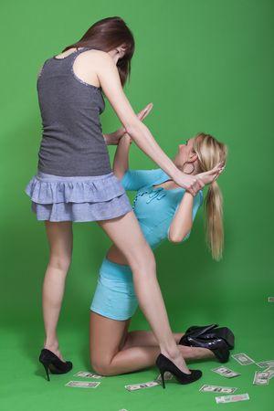 women fighting: two young women fighting