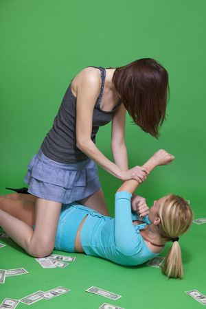 women fighting: women fighting on the ground over green background Stock Photo