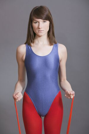 lycra: young woman doing fitness exercises with a elastic tape Stock Photo