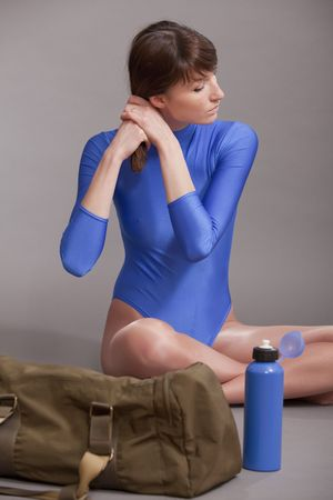fitness woman in blue leotard combing her hair for the training Stock Photo - 6837833