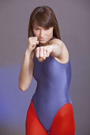 lycra: portrait of punching woman in violet leotard
