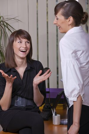 two young business women in happy conversation Stock Photo - 6892080
