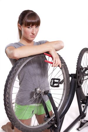 defect: woman with defect bike