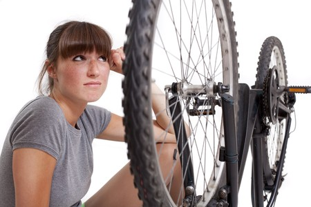 unhappy woman with defect bike Stock Photo - 7204505