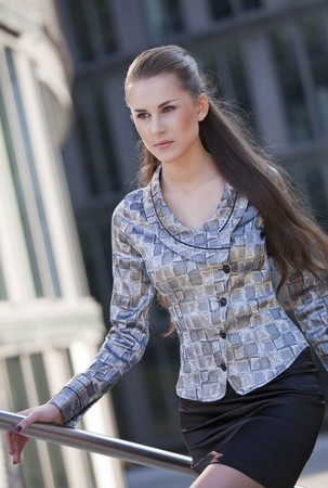 portrait of young businesswoman rushing photo