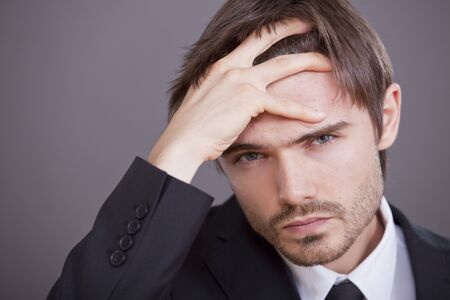 Portrait of young stressed businessman Stock Photo - 7515590