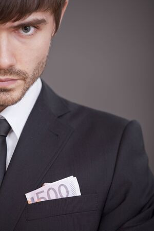 half portrait of businessman with money in the jacket Stock Photo - 7515593