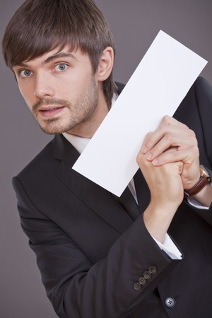 happy businessman holding blank card to write your own message photo
