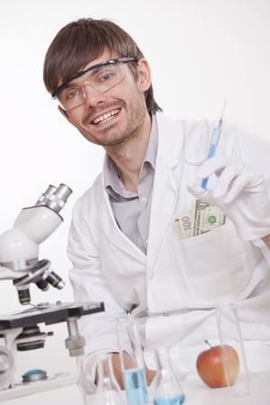 manipulating: corrupted scientist with syringe manipulating doping substances