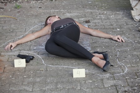 casualty: crime scene - female body outlined on the ground