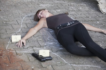 unconscious: crime scene - killed woman outlined on the ground