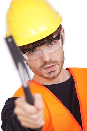 angry manual worker pointing hammer at the camera Stock Photo - 7618168