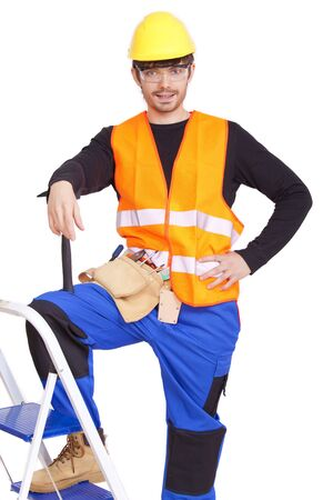 ladder safety: happy male carpenter posing on white background