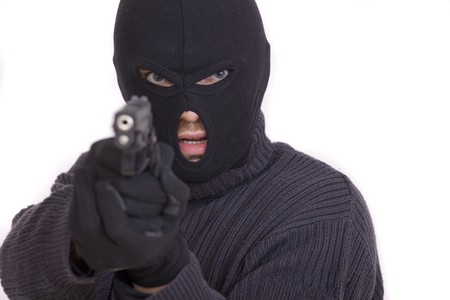 thief with gun aiming into a camera - isolated on white background Stock Photo - 7615729