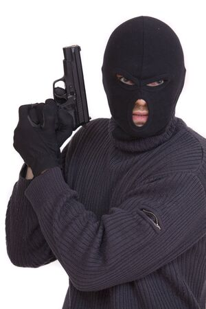 balaclava: terrorist in balaclava with gun on white background