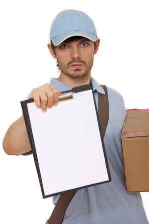 serious delivery man bringing a package and holding out a clipboard on white background photo