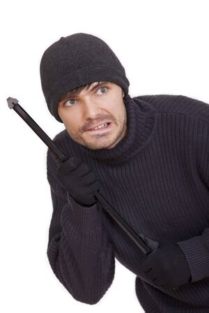 sneaking: burglar with crowbar sneaking - isolated on white background Stock Photo