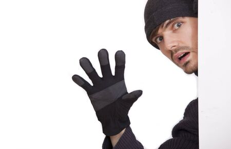 perpetrator: burglar stretching out the hand on a white background Stock Photo