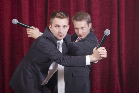 showman: two comedians with microphones acting on the stage Stock Photo