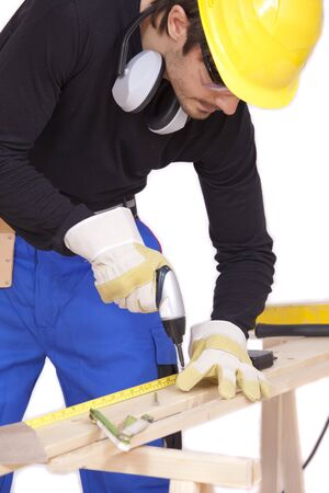 screwing: construction worker screwing with power tools Stock Photo