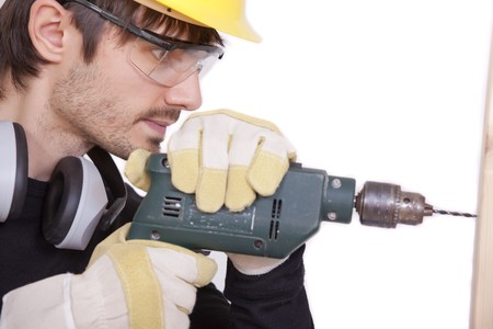 carpenter drilling in woods Stock Photo