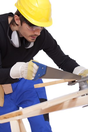 carpenter sawing woods photo