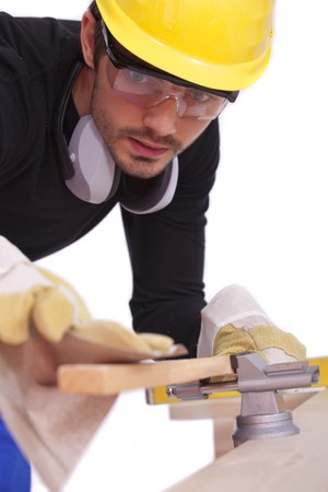 sandpaper: male carpenter working with sandpaper on woods - isolated on white Stock Photo