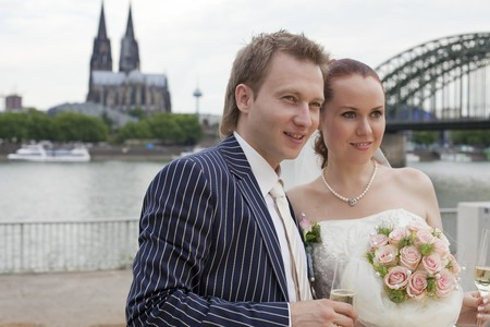 wedding couple outdoor - cologne cathedral in background photo