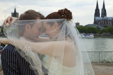love wedding couple outdoors - cologne cathedral in background photo