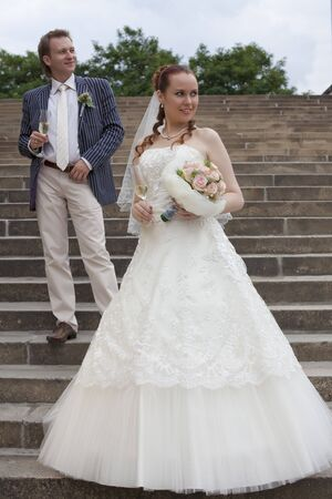just married couple standing on the stairs photo