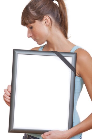 sad woman holding empty picture frame with black band isolated on white Stock Photo - 7826178