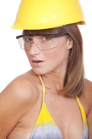 sexy young woman in yellow helmet on white background photo