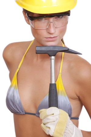 bikini construction: sexy female worker with hammer and helmet Stock Photo