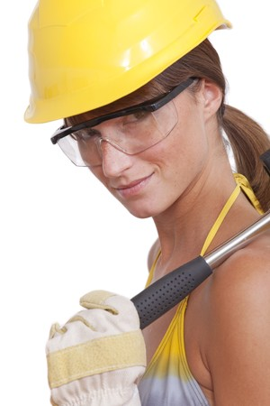 bikini construction: young female worker with hammer on white background