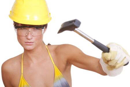 bikini construction: woman in helmet with hammer on white background