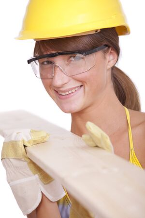 bikini construction: happy female worker with wood on white background