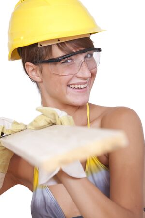 bikini construction: woman in bikini and helmet carrying wood on white background