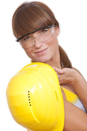 bikini construction: woman worker with yellow helmet on white background