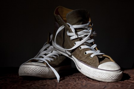 trendy sport shoes on a black background photo