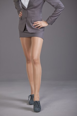 legs stockings: business woman in short skirt and nylon pantyhose