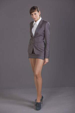 suit skirt: Portrait of business woman over grey background Stock Photo