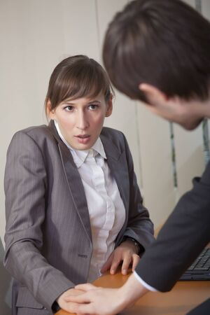 harassing: office scene - sexual harassment by the work Stock Photo