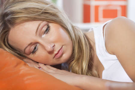 sad and depressed woman lying on pillow at home Stock Photo - 8631210