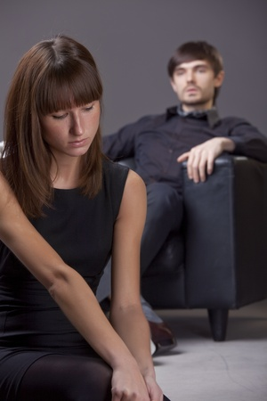 sad woman and proud man - focus on woman photo
