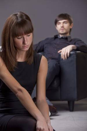 sad woman and proud man - focus on woman photo