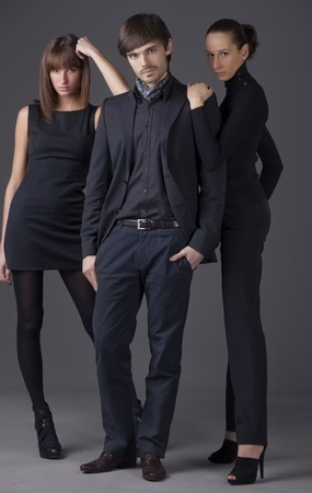 catwalk model: fashion people - man and two women in elegant dresses Stock Photo