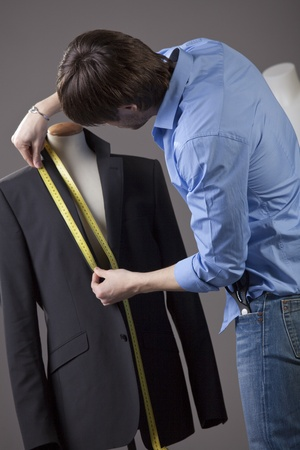 male tailor by the work on business jacket Stock Photo