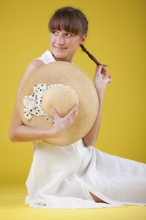 modest: modest woman in summer dress over yellow background
