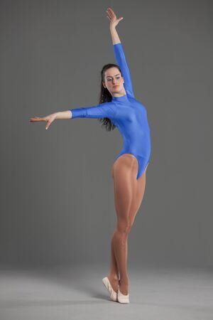 lycra: female ballet dancer in leotard over grey background Stock Photo